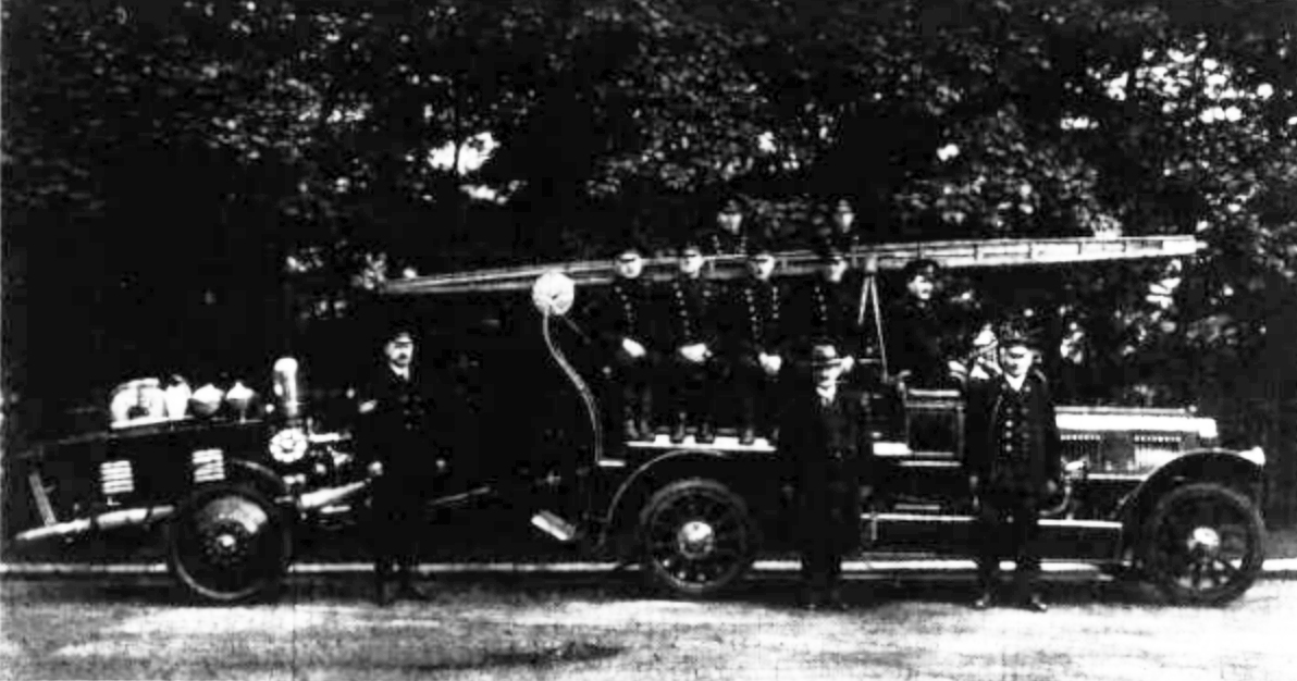 Merryweather engine with a small portable motor hose tender 1923