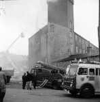 Workmen Drag Gas Cylinders From Mill Blaze (4 of 7)