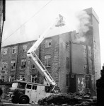 Workmen Drag Gas Cylinders From Mill Blaze (5 of 7)