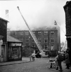 Workmen Drag Gas Cylinders From Mill Blaze (6 of 7)
