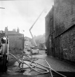 Workmen Drag Gas Cylinders From Mill Blaze (7 of 7)